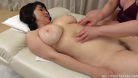 Mizuno Yoshie gives a massage to a chubby Asian chick and licks their way pussy
