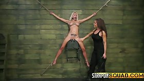 Sextractive blonde with fake boobs Marsha May is secured up and punished wide of brunet mistress