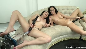 Lesbians having sex machines together